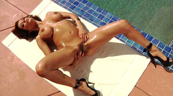 Francesca Le oils her bush up pool side.