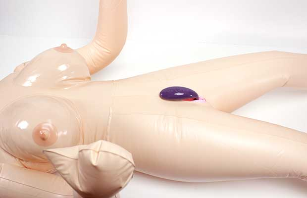 The bottom half slides in your vagina and the top half lays against you clitoris. It stays in place even during intercourse.